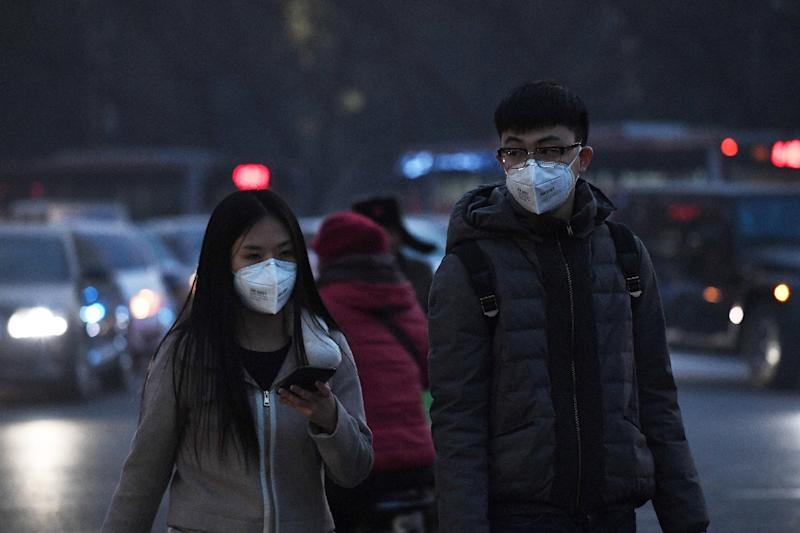 Pedestrians have been wearing masks to protect themselves from pollution in Beijing, as smog shrouds northeast China