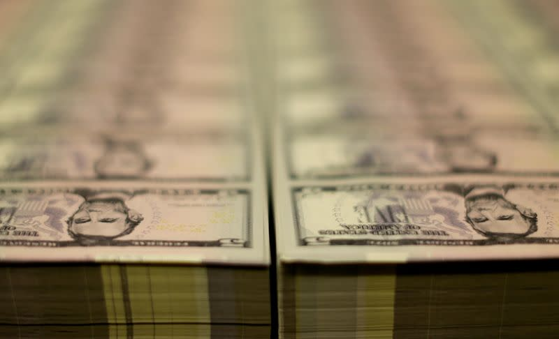 FILE PHOTO: Stacks of Lincoln five dollar bill are seen at the Bureau of Engraving and Printing in Washington
