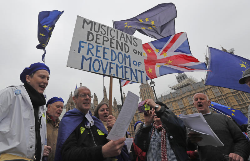 The Latest: Parliament OKs law barring Brexit without deal