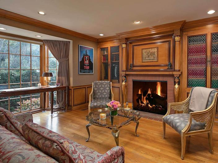 communal seating by a fireplace