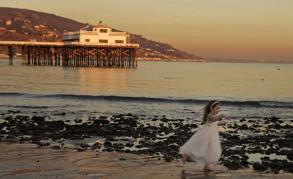 """<p>A short drive from Los Angeles, <a href=""""https://www.visitcalifornia.com/experience/malibu"""" rel=""""nofollow noopener"""" target=""""_blank"""" data-ylk=""""slk:Malibu"""" class=""""link rapid-noclick-resp"""">Malibu</a> is a luxury surfer's paradise that entranced tourist during the 2006 season. </p>"""