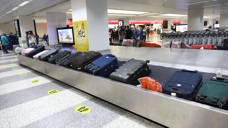 Conveyor belt with suitcases at an airport