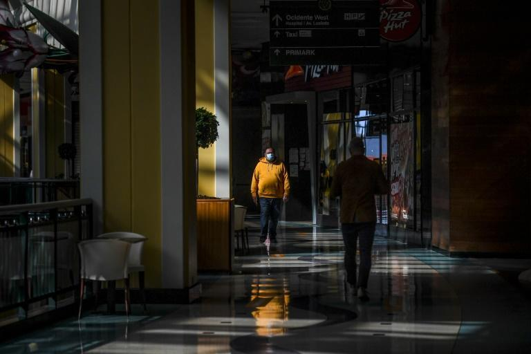 Customers shopping in a newly reopened mall in Portugal