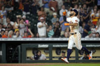 Houston Astros' Abraham Toro (13) celebrates after hitting a two-run home run against the Chicago White Sox during the seventh inning of a baseball game Thursday, June 17, 2021, in Houston. (AP Photo/David J. Phillip)