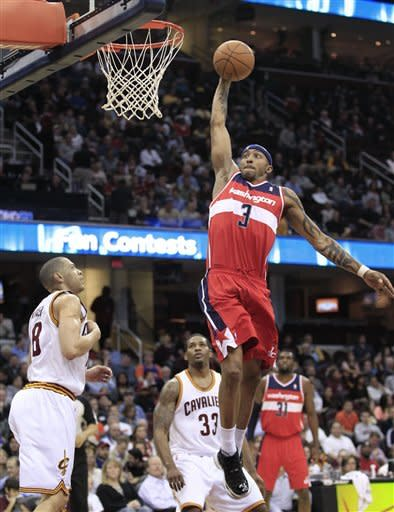 Washington Wizards' James Singleton (3) jumps to the basket against Cleveland Cavaliers' Anthony Parker (18) in the third quarter in an NBA basketball game on Wednesday, April 25, 2012, in Cleveland. Washington won 96-85. (AP Photo/Tony Dejak)