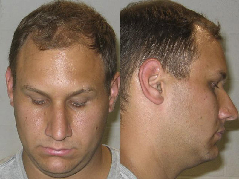 This undated photo released by the Shaker Heights police department shows the booking photo of Andrew Martin. Martin, 23, of Bristolville, near Warren, Ohio, allegedly tried to resolve a house ownership fight by offering $10,000 to kill the dead owner's sister. Martin has pleaded not guilty and his trial is scheduled Feb. 7 in U.S. District Court in Cleveland. (AP Photo/Shaker Heights Police Department)