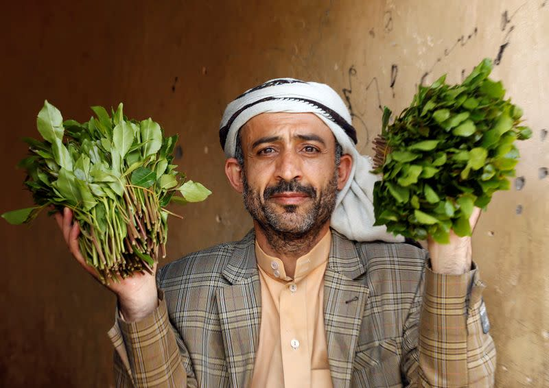 Vendor showsqat, a mild stimulant, as he waits for customers at a qat market amid concerns of the spread of the coronavirus disease (COVID-19) in Sanaa