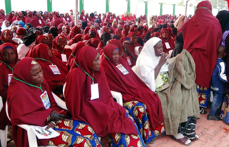 Brides attend a wedding feast at the Kano state governor's office after taking part in a mass wedding at the central mosque in Nigeria's second city of Kano on December 19, 2013 (AFP Photo/Aminu Abubakar)