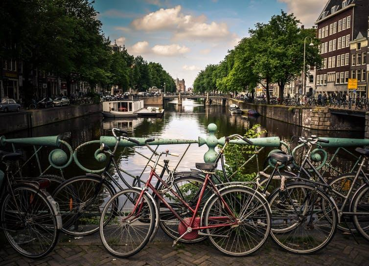 """<span class=""""caption"""">Cycling is a major mode of transport in the Netherlands.</span> <span class=""""attribution""""><a class=""""link rapid-noclick-resp"""" href=""""https://unsplash.com/photos/VEXIwDcY1gw"""" rel=""""nofollow noopener"""" target=""""_blank"""" data-ylk=""""slk:Jace & Afsoon/Unsplash"""">Jace & Afsoon/Unsplash</a>, <a class=""""link rapid-noclick-resp"""" href=""""http://artlibre.org/licence/lal/en"""" rel=""""nofollow noopener"""" target=""""_blank"""" data-ylk=""""slk:FAL"""">FAL</a></span>"""