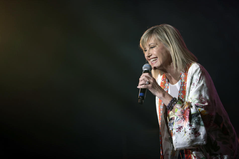 Olivia Newton-John (pictured performing in Australia earlier this year) will take the virtual stage as part of the Global Pride 2020 lineup. (Photo: Cole Bennetts/Getty Images)