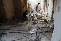 Workers renovate the long-abandoned 200-year-old Ghussein palace, in the old quarter of Gaza City, Monday, Dec. 14, 2020. Less than 200 of these old houses are still partly or entirely standing, according to officials and they are threatened by neglect, decaying and urban sprawl. (AP Photo/Adel Hana)