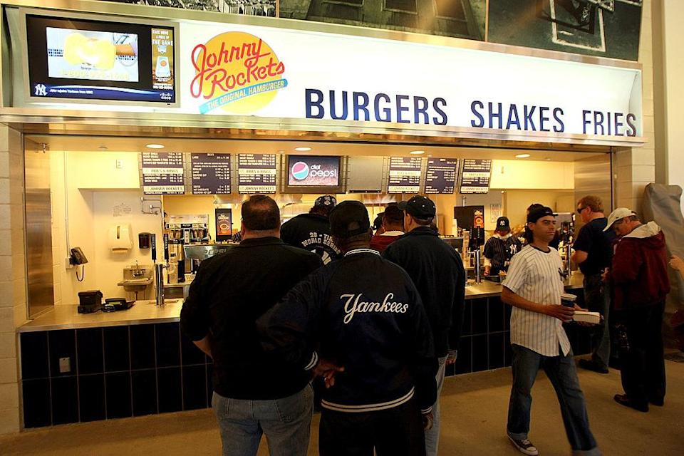 people ordering from a johnny rockets stand