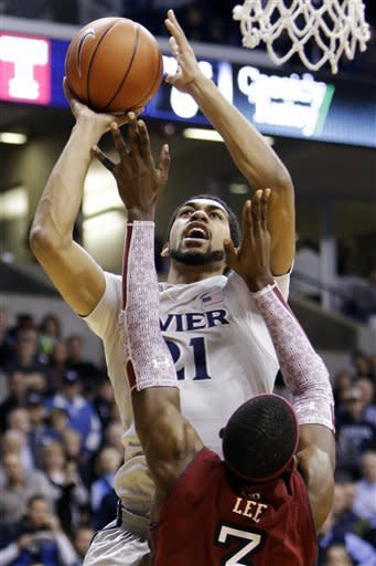 Xavier forward Jeff Robinson (21) shoots over Temple forward Anthony Lee (7) in the first half of an NCAA college basketball game, Thursday, Jan. 10, 2013, in Cincinnati. (AP Photo/Al Behrman)