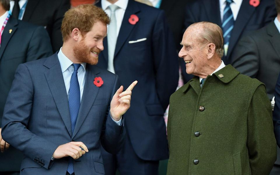 Prince Harry and Prince Philip, Duke of Edinburgh attend the 2015 Rugby World Cup Final match between New Zealand and Australia at Twickenham Stadium on October 31, 2015 in London, England - Max Mumby/Indigo
