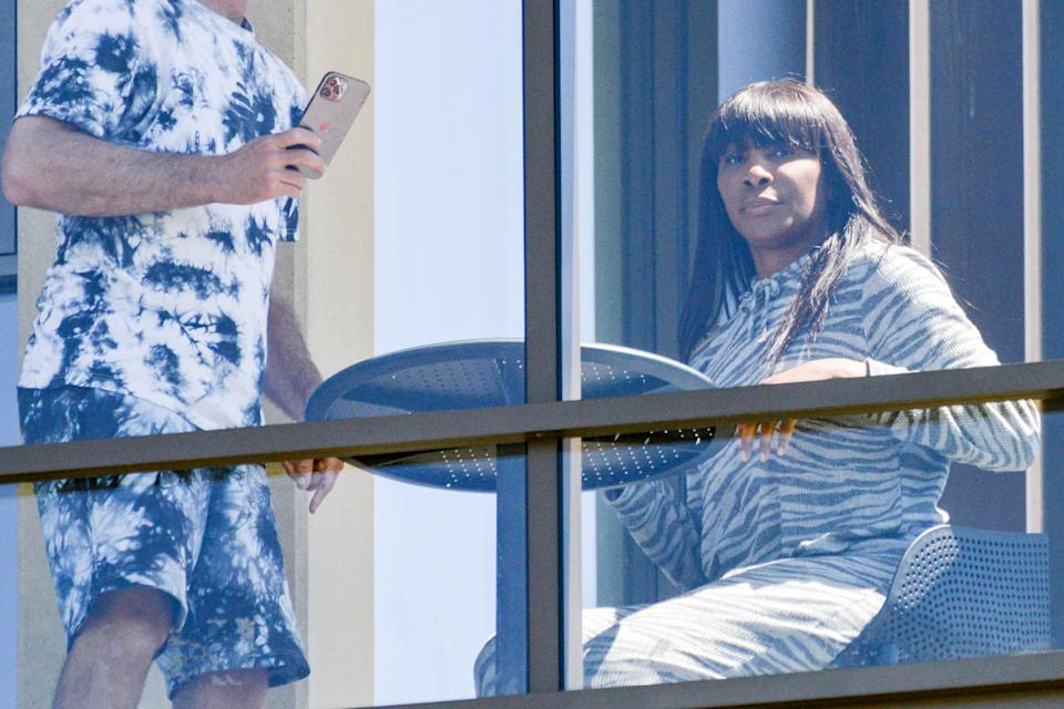 TOPSHOT - US women's tennis player Venus Williams sits on her hotel balcony in Adelaide on January 22, 2021, one of the locations where players are quarantining for two weeks ahead of the Australian Open in Melbourne. (Photo by Brenton EDWARDS / AFP) / -- IMAGE RESTRICTED TO EDITORIAL USE - STRICTLY NO COMMERCIAL USE -- (Photo by BRENTON EDWARDS/AFP via Getty Images)