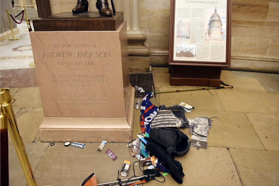 <p>Some rioters left their belongings, including pro-Trump paraphernalia, strewn about the Capitol building. </p>