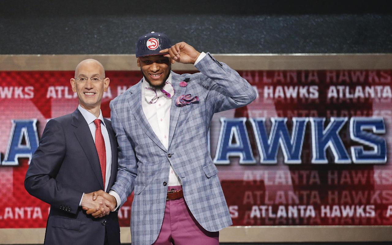 Michigan State's Adreian Payne, right, poses for a photo with NBA commissioner Adam Silver after being selected as the 15th overall pick by the Atlanta Hawks during the 2014 NBA draft, Thursday, June 26, 2014, in New York. (AP Photo/Jason DeCrow)