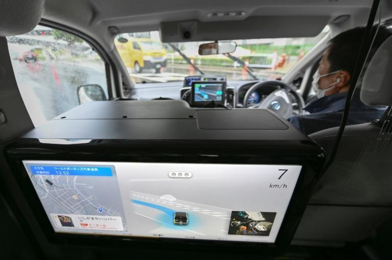 Analysts say it is difficult to predict when autonomous taxis will be commercially available in Japan (AFP/Kazuhiro NOGI)