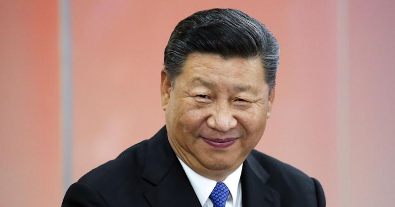 Chinese President Xi Jinping reacts during a session at the Eastern Economic Forum in Russia.