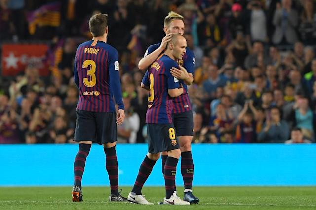 Iniesta takes his final bow after 22 years at Barcelona (AFP Photo/LLUIS GENE)