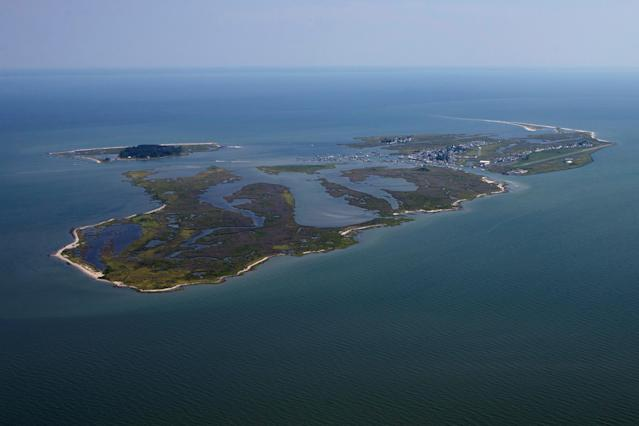 <p>Tangier Island is photographed from the north side in this aerial view over Chesapeake Bay, Virginia, Aug. 2, 2017. (Photo: Adrees Latif/Reuters) </p>