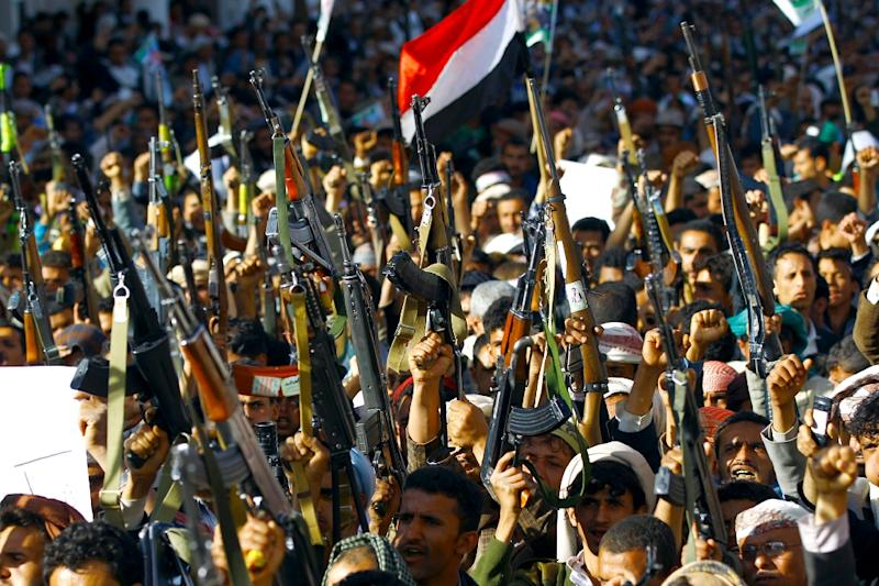 """Supporters of the Shiite Huthi movement brandish their weapons as they take part in a demonstration in the capital Sanaa on April 22, 2015, against the Saudi-led military """"Decisive Storm"""" air campaign targeting Huthi rebels and their allies in Yemen (AFP Photo/Mohammed Huwais)"""