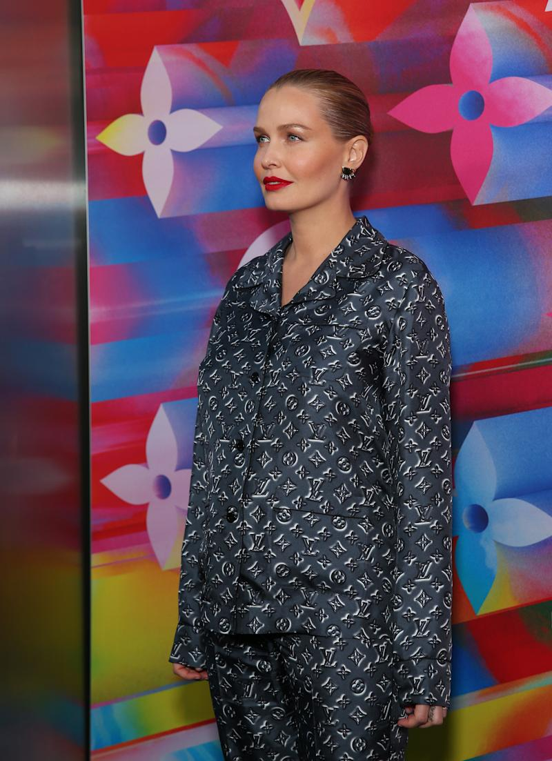 Lara Worthington showed off the first hints of a baby bump at the re-opening of Louis Vuitton's Sydney flagship store. Photo: Getty Images