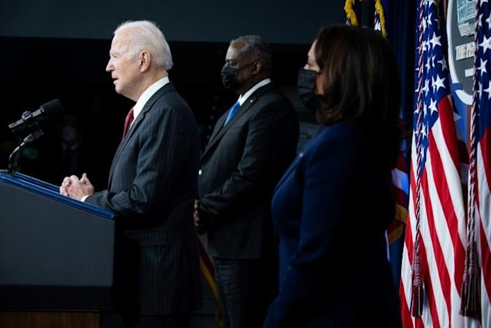 "President Joe Biden promised the US defense force he ""will never politicize the work you do,"" as Vice President Kamala Harris and Defense Secretary Lloyd Austin stood at his side"