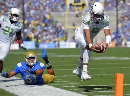 Oregon's Marcus Mariota has a strong case for taking home the Heisman Trophy on Saturday. (AP)