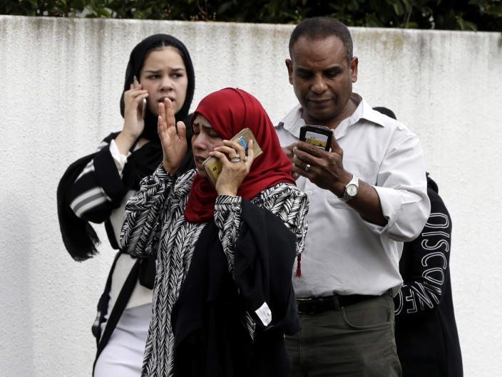 <p>People wait outside a mosque in central Christchurch, New Zealand. (AP Photo/Mark Baker) </p>