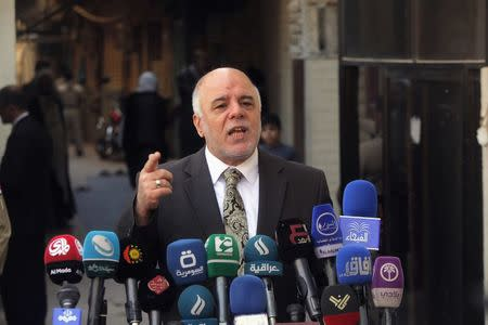 Iraqi Prime Minister Haider al-Abadi speaks at a news conference during his visit to Najaf, south of Baghdad