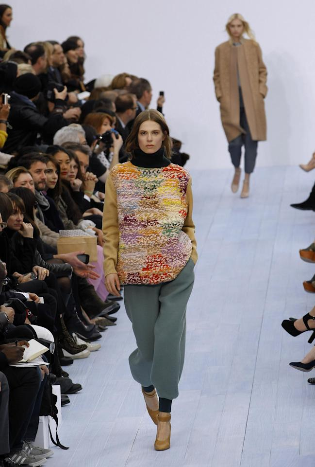 A model wears a creation by designer fashion designer Clare Waight Keller for Chloe as part of the Fall-Winter, ready-to-wear 2013 fashion collection, during Paris Fashion week, Monday, March. 5, 2012. (AP Photo/Christophe Ena)