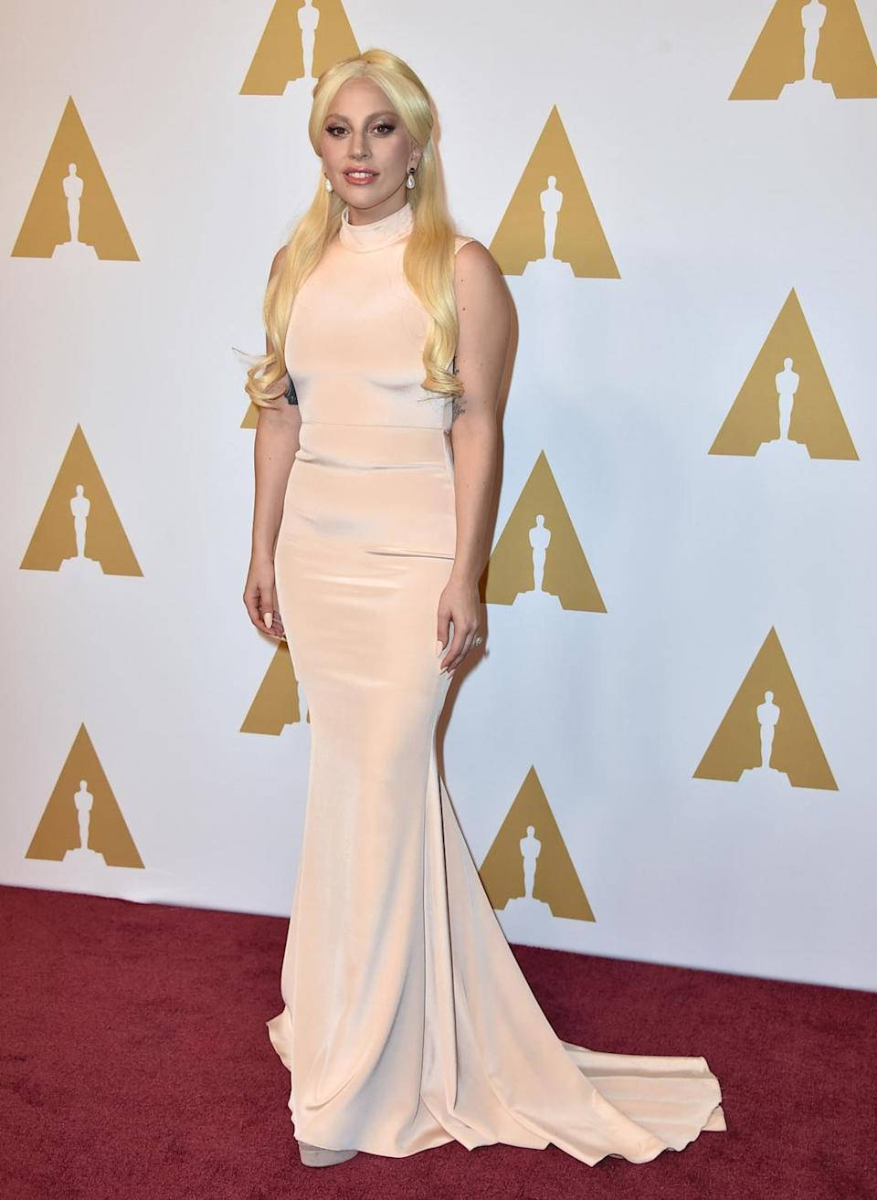 <p>The singer, who performed the National Anthem in Santa Clara at the Super Bowl on Sunday, switched gears less than 24 hours later. At the Oscar nominees luncheon, Lady Gaga wore a cream-colored gown with her blonde hair (or, rather, someone else's) pulled into a half-up, half-down 'do. <i>Photo: AP</i></p>
