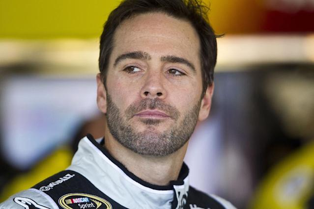 Jimmie Johnson waits for practice laps for the NASCAR Sprint Cup Series auto race to start on Friday afternoon, Nov. 8, 2013, at Phoenix International Raceway in Avondale, Ariz. (AP Photo/The Arizona Republic. Patrick Breen)