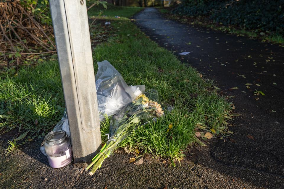 Flowers left at the scene where Police search undergrowth in Fistoft, Boston, Lincolnshire. (SWNS)