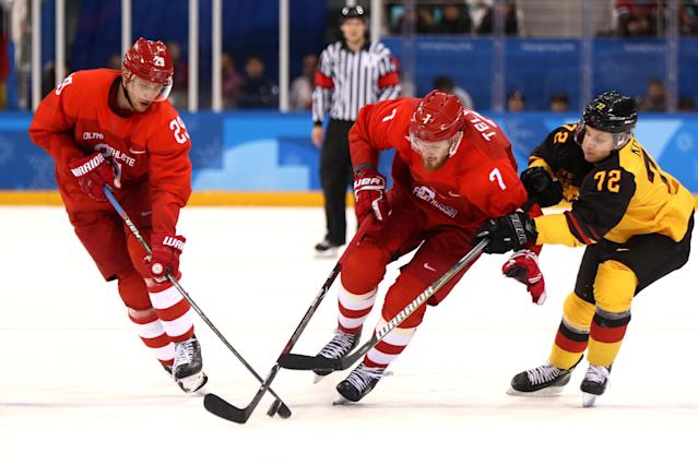 <p>Dominik Kahun #72 of Germany competes for the puck against Ilya Kablukov #29 and Ivan Telegin #7 of Olympic Athlete from Russia in the third period during the Men's Gold Medal Game on day sixteen of the PyeongChang 2018 Winter Olympic Games at Gangneung Hockey Centre on February 25, 2018 in Gangneung, South Korea. (Photo by Jamie Squire/Getty Images) </p>