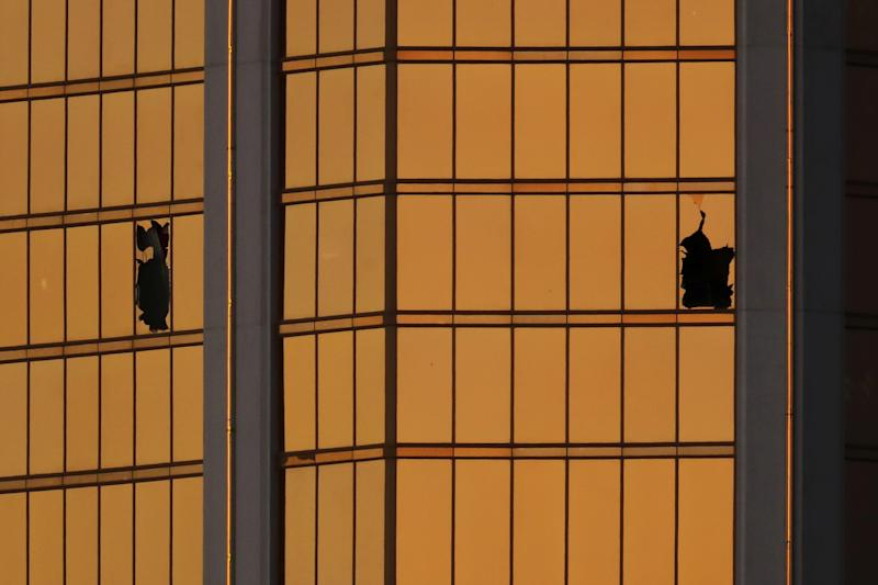 Broken windows are seenon the 32nd floor of the Mandalay Bay hotel in Las Vegas, where Stephen Paddock fired on a crowd below in early October. At least 15 states and a number of local jurisdictions have taken taken up proposals to ban bump stocks since the shooting. (Mike Blake / Reuters)