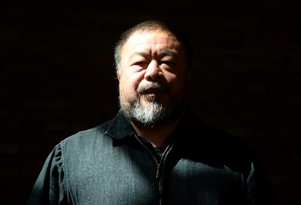 "Chinese dissident and internatioanlly renowned artist Ai Weiwei, pictured in April 2014, says he feels that people pushed away from their home ""are part of me and I am part of them"" (AFP Photo/GOH Chai Hin)"