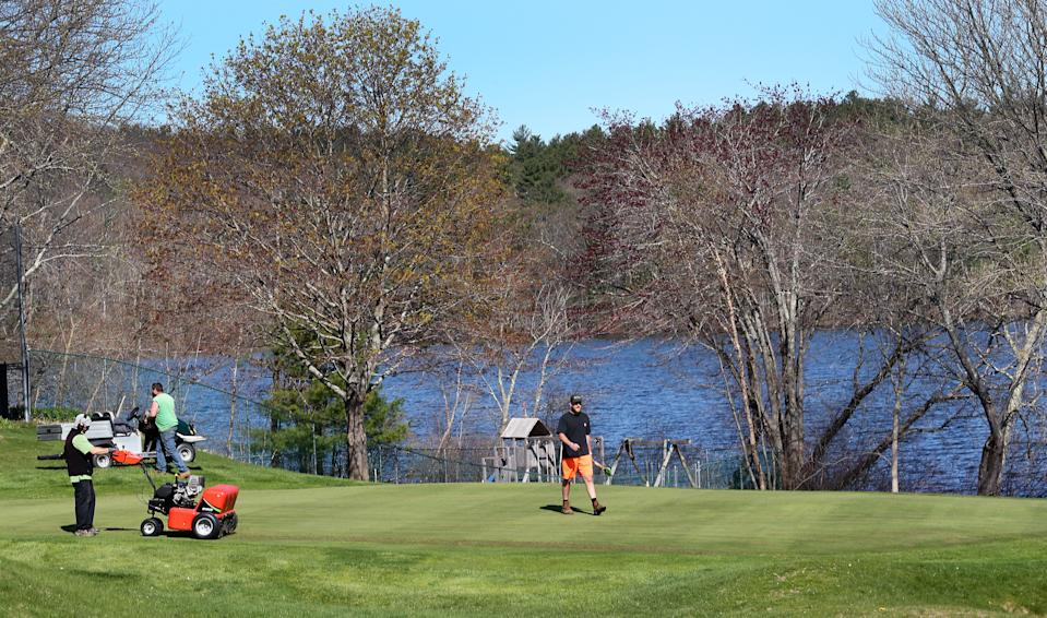 NORTH ANDOVER, MA - MAY 4: Although all golf courses in Massachusetts are still ordered to stay closed by governor Charlie Baker, workers at the North Andover Country Club in North Andover, MA work on the grass on May 4, 2020, getting the course ready for when they eventually are allowed to re-open. (Photo by Jim Davis/The Boston Globe via Getty Images)