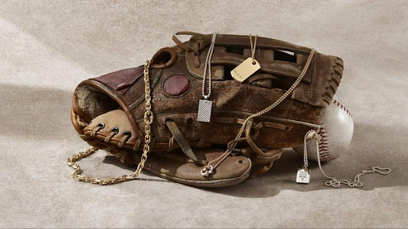 A worn baseball glove is draped in Tiffany's new jewelry for dudes