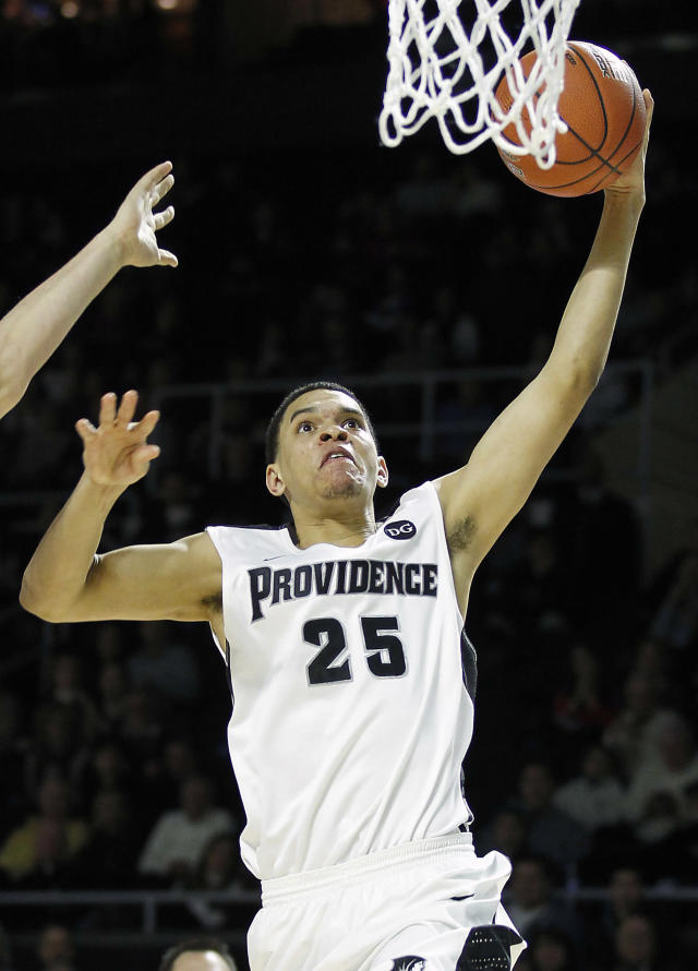 Providence forward Tyler Harris (25) dunks the ball after a steal during the second half of an NCAA college basketball game against Creighton, Saturday, Jan. 18, 2014, in Providence, R.I. Providence defeated Creighton 81-68. (AP Photo/Stew Milne)