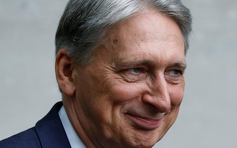 Britain's Chancellor of the Exchequer Philip Hammond leaves the BBC studios in London, Britain, July 21, 2019. REUTERS/Henry Nicholls