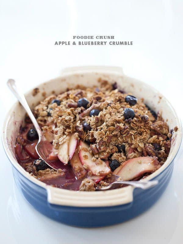 "<strong>Get the <a href=""https://www.foodiecrush.com/apple-blueberry-crumble/"" rel=""nofollow noopener"" target=""_blank"" data-ylk=""slk:apple and blueberry crumble recipe"" class=""link rapid-noclick-resp"">apple and blueberry crumble recipe</a> from FoodieCrush.</strong>"
