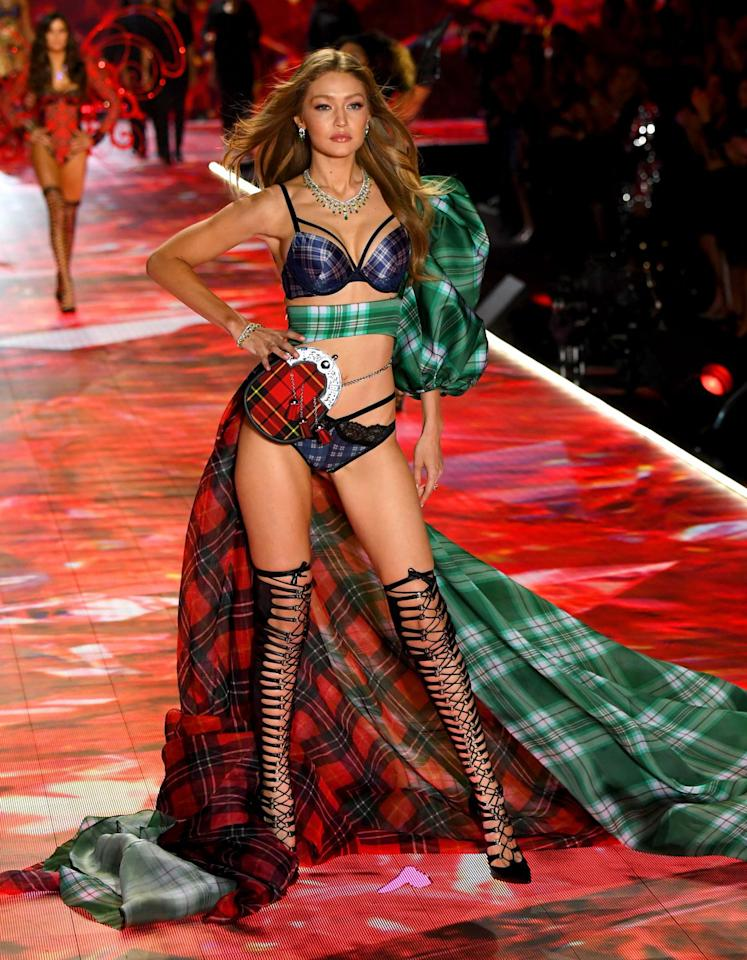 <p>In a matching lingerie set with a dramatic tartan train. </p>