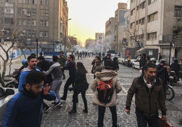 <p>In this photo taken by an individual not employed by the Associated Press and obtained by the AP outside of Iran, people are affected by tear gas fired by anti-riot Iranian police to disperse demonstrators in a protest over Iran's weak economy, in Tehran, Iran, Saturday, Dec. 30, 2017. (Photo: AP) </p>