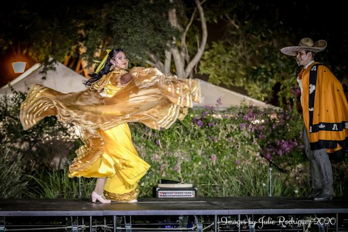 """Two dancers perform the """"Tale as Old as Time"""" number from the Disney suite. <span class=""""copyright"""">(Julie Rodriguez)</span>"""