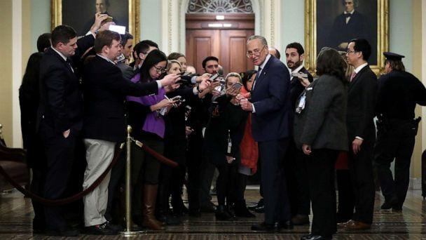 PHOTO: Senate Minority Leader Chuck Schumer talks to reporters who are restricted to a pen on the second floor of the U.S. Capitol during a break in the impeachment trial of President Donald Trump on Jan. 21, 2020 in Washington, D.C. (Chip Somodevilla/Getty Images)