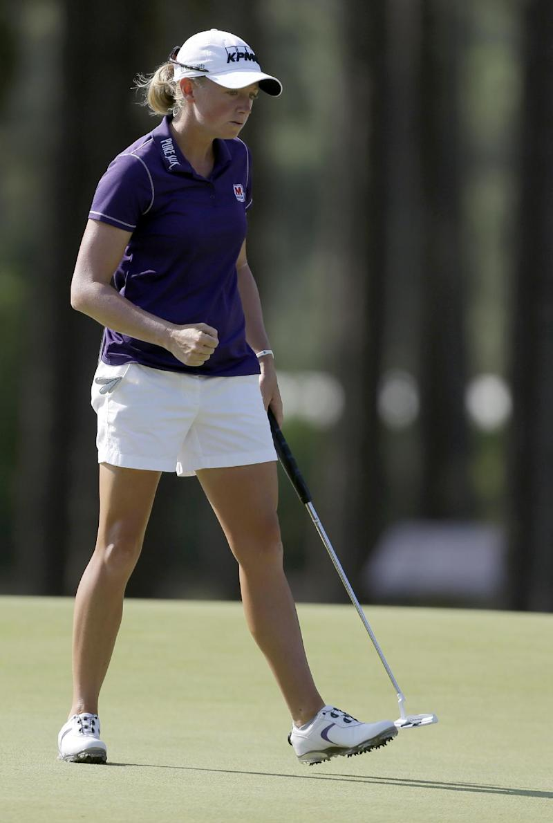 Top-ranked Lewis opens Women's Open with 67