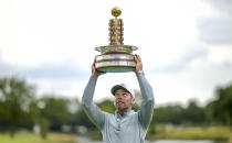 England's Pauls Casey celebrates with the trophy after winning the European Open golf tournament, in Hamburg, Germany, Sunday Sept. 8, 2019. (Axel Heimken/dpa via AP)