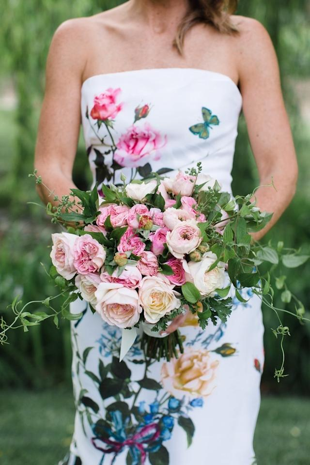 "At this colorful <a rel=""nofollow"" href=""https://www.brides.com/story/a-film-producers-vibrant-estate-wedding-in-napa-valley?mbid=synd_yahoo_rss"">California wedding</a>, florist Kathleen Deery surprised the bride with two bouquets to choose from. ""She had not seen much of my dress and wanted to compliment the colors well,"" says the bride. The winning choice? A bunch of pink rose varieties surrounded by ivy."
